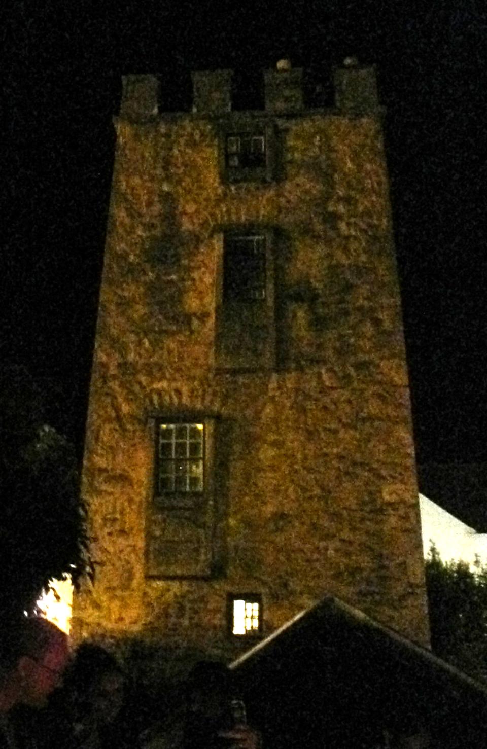 The Curfew Tower by bonfire light