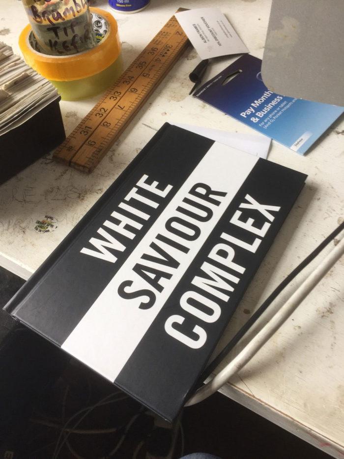 White Saviour Complex book on desk